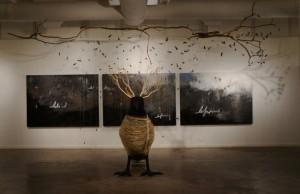 "Three works by Michelle Firment Reid: ""Fisher of Thoughts"" (foreground), ""Taking Flight"" (hanging mobile) and ""These Thoughts They Travel"" (wall installation). Photo courtesy of artist."