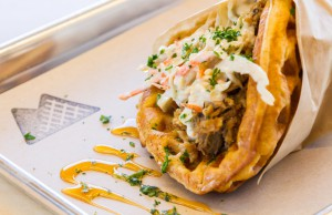 The pulled pork waffle is served with Maytag bleu cheese slaw and Tobasco honey sauce. Photo by J. Christopher Little.