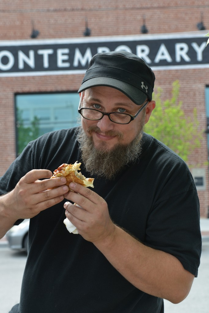 Greg Shocklee enjoys a sausage at lunchtime from The Wurst. Photo by Natalie Green.