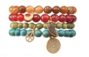 Beaded bracelets with crystal charms in brown agate, $70, garnet, $88, fern agate, $60, and peacock, $95, On A Whim