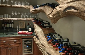 "An eye-catching ""Tree of Life"" holds the couple's large wine collection. Photo by David Cobb."