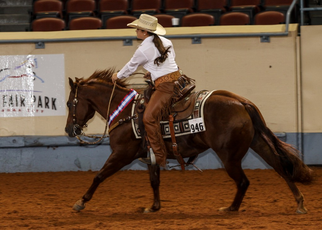 Shelby Reine of La Place, La., and rides Topsail Oak in the AQHYA World Championship Show in 2013. Photo by and courtesy of The American Quarter Horse Journal.