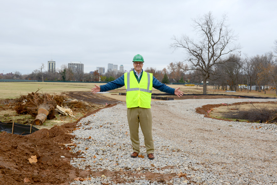 Jeff Stava, executive director of Tulsa's Gathering Place, Llc, stands on land near riverside drive that eventually will be transformed into a gathering place.  Photo by Natalie Green.