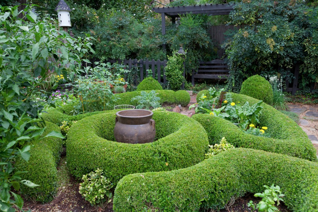 Linda Vater's garden, 20 years in the making, features boxwoods, mature trees and a potager. Photo by David Cobb.