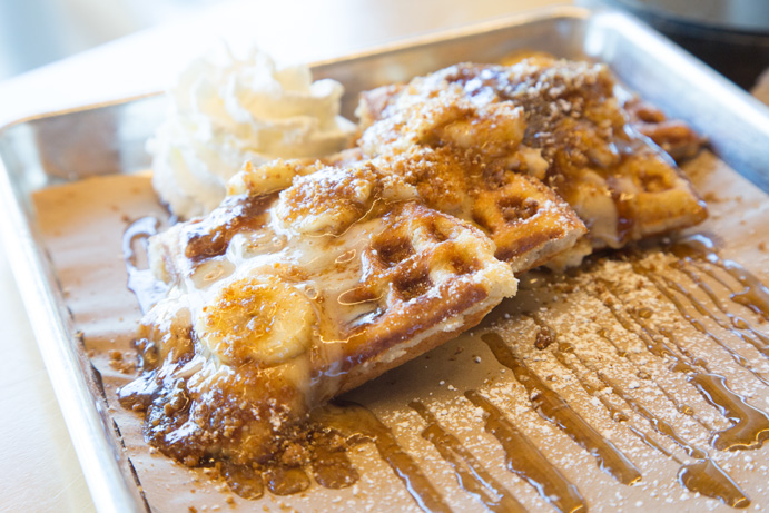 A crispy waffle is topped with brown sugar, rum bananas and fluffy whipped cream. Photo by Brent Fuchs.