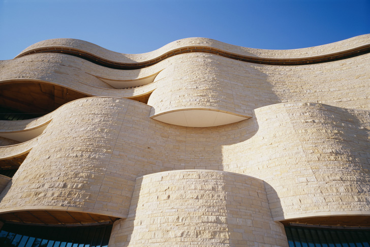The National Museum of the American Indian has a curvilinear architecture.  Photo courtesy Smithsonian National Museum of the American Indian.