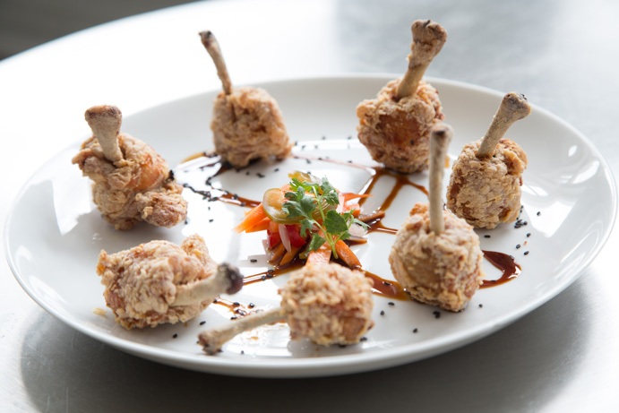 The Chicken Lollipops, chicken wings brined to tenderness  and then cooked, are a signature appetizer of Guernsey Park. Photo by Brent Fuchs.