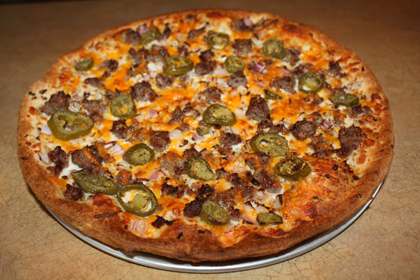 Hideaway Pizza's Oktoberfest-inspired pie returns, featuring a garlic glaze with Bavarian mustard, mozzarella, sauerkraut, bratwurst, red onion, cheddar and jalapenos. www.hideawaypizza.com