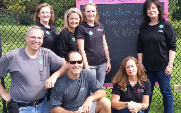 GableGotwals employees install chalkboards in the play area at CAP Tulsa. Photo courtesy GableGatwals.