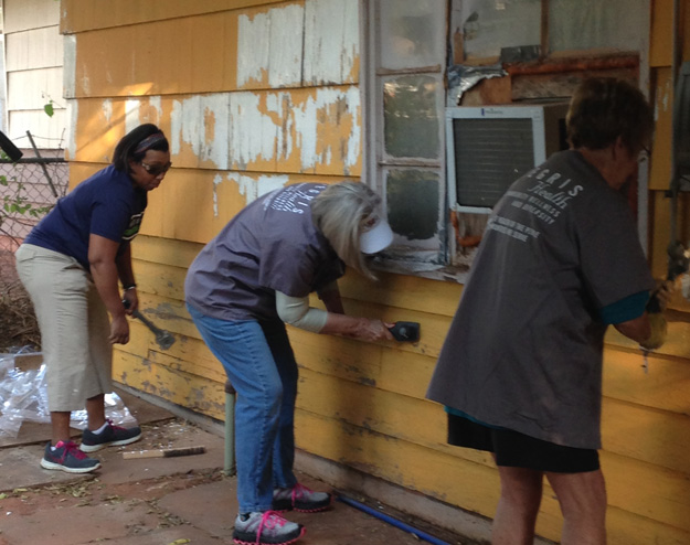 Members of INTEGRIS Health's ICREW work with Rebuilding Together of Oklahoma City to make improvements to the home of a disabled woman.