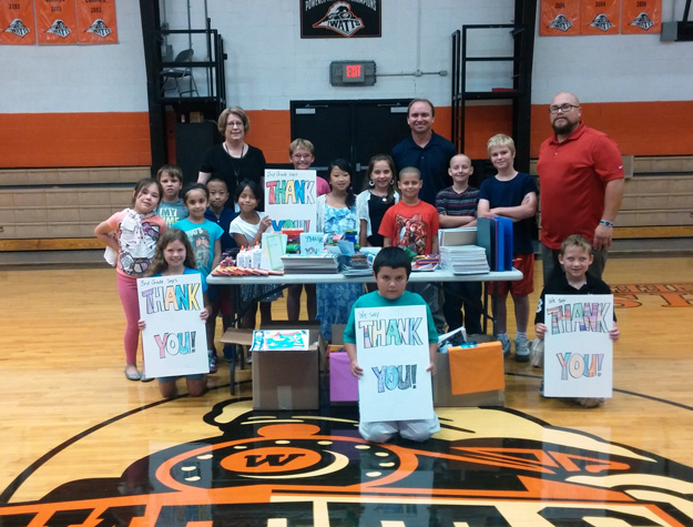 Cherokee Nation Businesses employees work with local schools as part of outreach.
