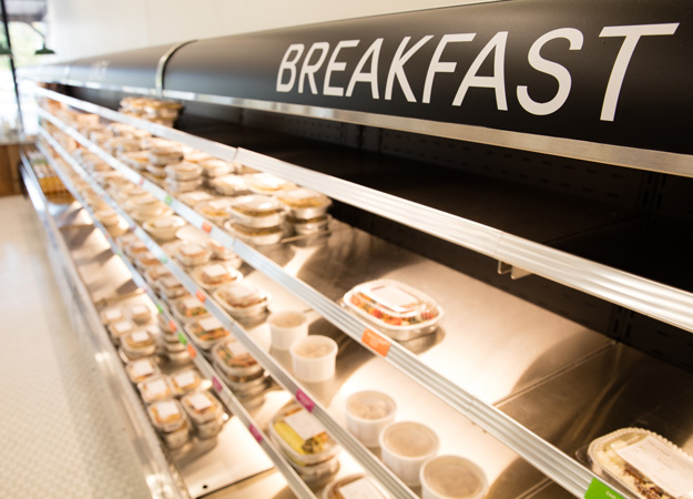 Refrigerated cases hold prepared entrees and sides for breakfast, lunch and dinner. Photo by Brent Fuchs