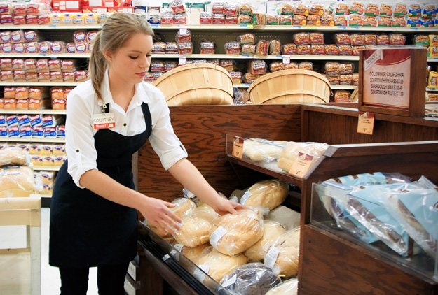 A Reasor's employee readies items in the bakery.