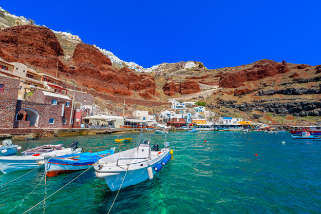 Fishing boats are gathered in the fishing village of Cyclades on Santorini.