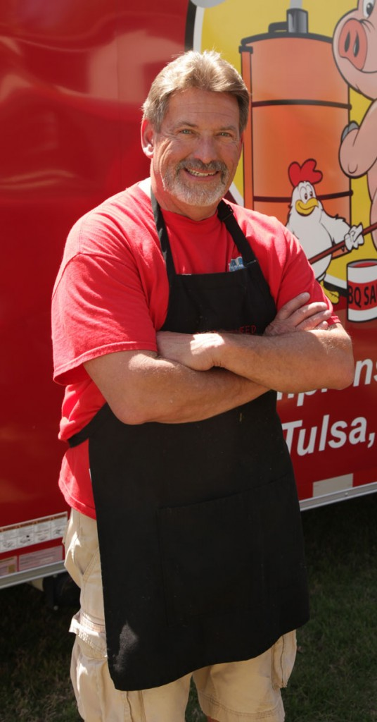 Tulsa Attorney Brad Beasley competes in 25 to 30 barbecue competitions each year. Photo by Marc Rains.