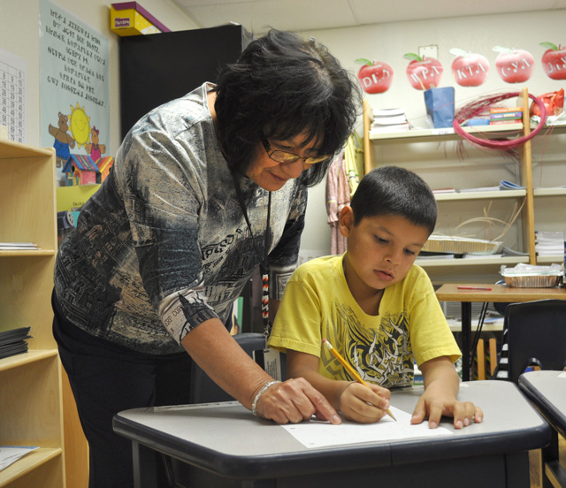 Cherokee Immersion Charter School teacher Meda Nix working with a student. Photo courtesy Cherokee Nation