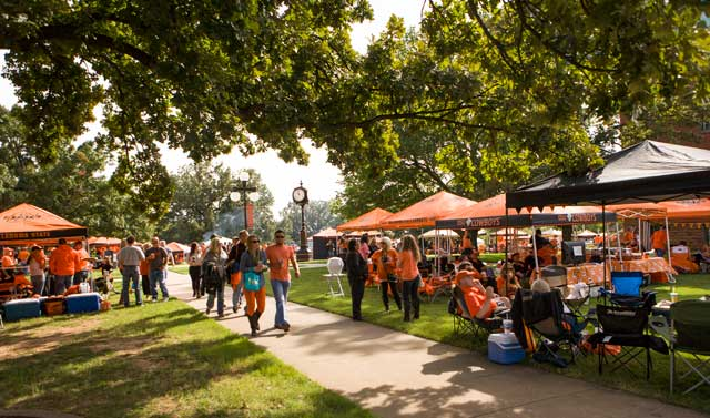 Decked out in distinct orange, Cowboys fans socialize, tailgate and relax before a game. Photo by Gary Lawson. Courtesy OSU Marketing.