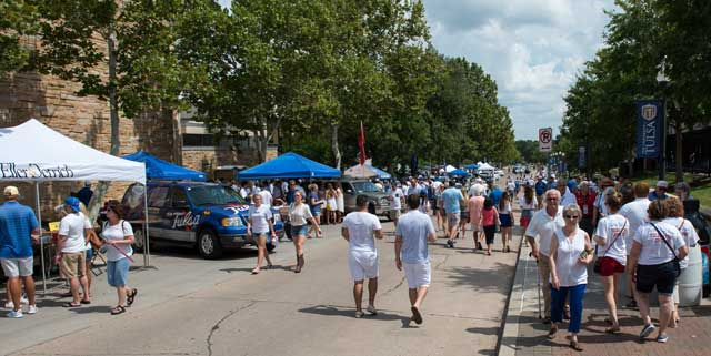 Hundreds of university of Tulsa fans flood the streets of campus before a big game. Photo by Brett Rojo, courtesy The University of Tulsa.